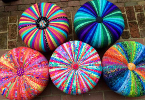 5 colorful tuffets on brick